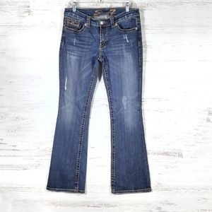 7FAM - dark blue unstoppable midrise boot cut jean